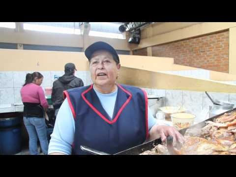 Hornado de chancho, tortillas de papa y mote. Recetas tradicionales.en Julio Andrade Ecuador