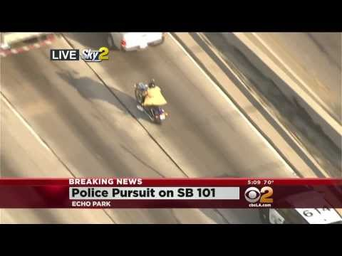 Crazy Police Chase: Suspect Ditches Cops By Taking Off His Coat & Walking Off! (News Crew Spots Him & Puts Him On Blast)