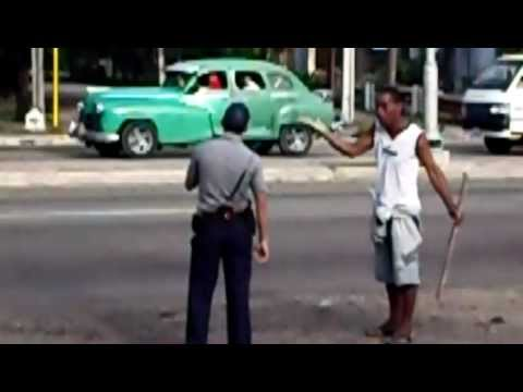 Policeman  fight with a drunk guy in Habana , Cuba,at a bus stop