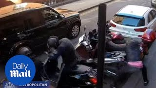 CCTV shows moped gang preparing to rob Boodles in London