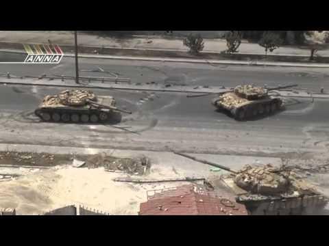 مقطع يظهر دبابات الاسد وهي تقصف حي القابون بشكل عنيف جداا ودمار هائل جداا وبشهادة القناة الروسية