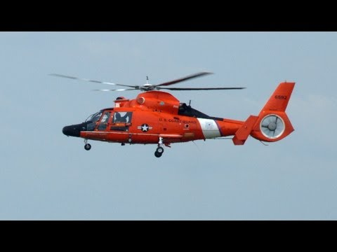 A HH-65C Dolphin helicopter from Coast Guard Air Station Detroit, MI had to make an emergency landing during the Thunder Over Michigan air show. At the 0:52 second mark you can see that the...