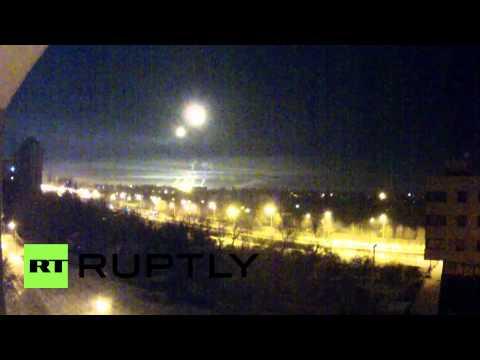 Ukraine: Illuminating shells light up Donetsk airport on NYE