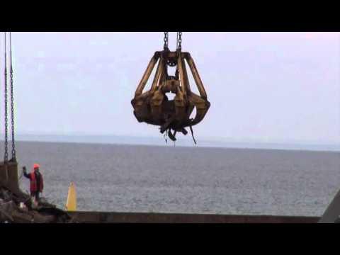 crane loads a cargo ship