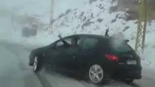 WTF! Peugeot 206 S16 Drifting on the snow.