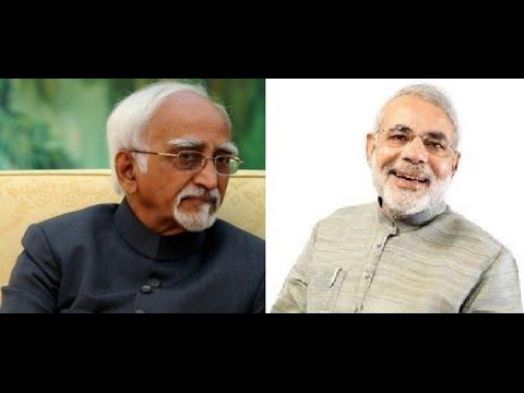 Vice Prez Hamid Ansari and PM Narendra Modi greet people on Holi
