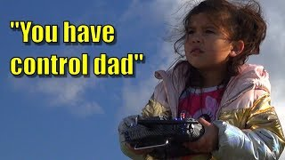 Daughter teaches father to fly RC plane