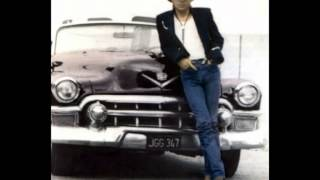 Watch Dwight Yoakam Claudette video
