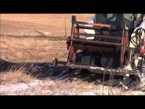 Rolling up barbed wire with Dakota Wire Winder and Post Puller
