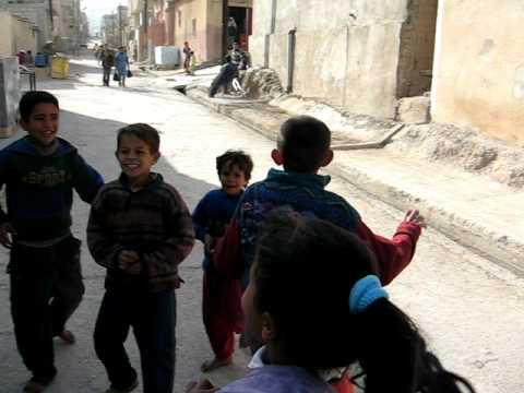 Palestinian children singing in the Gaza refugee Camp (Jerash, Jordan)