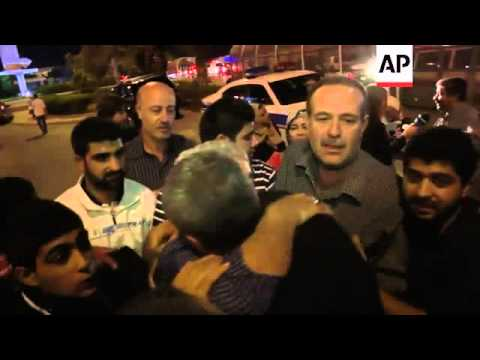 Nine Shiite pilgrims, held since May 2012, arrive in Beirut after being freed in hostage deal