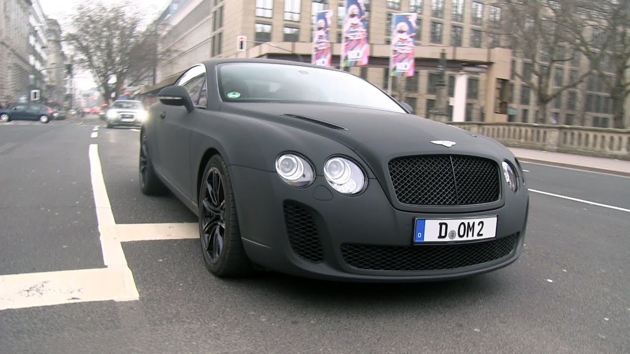 matte black bentley continental supersports driving in