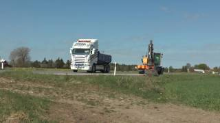 Volvo EW180D excavator clears a ditch from the ground and load on a Volvo and Scania truck Follingbo