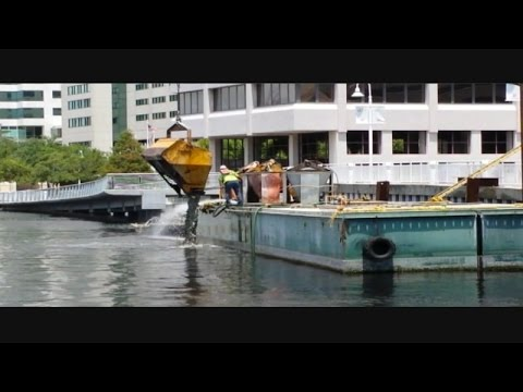 Video: Workers discard concrete into river?