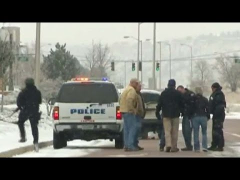 Colorado shooting witness saw officer 'go down'