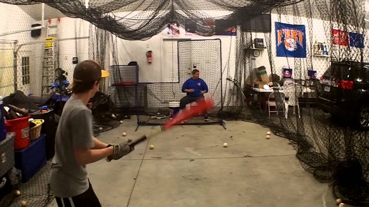 Giancarlo Stanton Hitting Batting cage is in the...