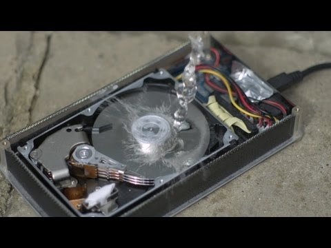 Cover Lagu How a Hard Drive works in Slow Motion - The Slow Mo Guys