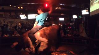 Osric Chau riding a mechanical bull