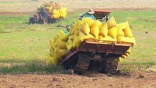 Xe cải tiến 2 cầu và máy kéo lúa bánh xích kéo lúa qua mương leo dốc