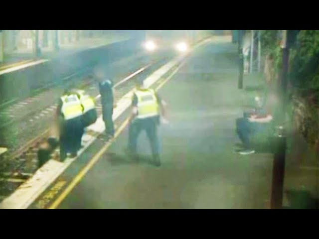 Woman in Bra Pulled From Train Tracks With Seconds to Spare