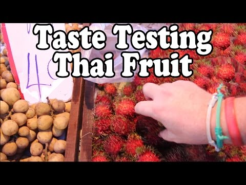Taste Testing Thai Fruits at a Thai Food Market. Exotic Fruit Shopping at a Market in Thailand Vlog