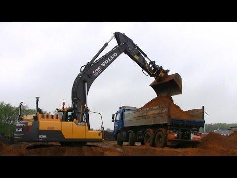 Volvo EC250D Excavator With Rototilt Loading Volvo Truck