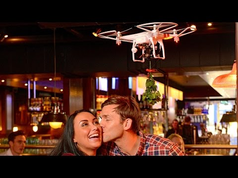 TGI Fridays' Mistletoe Drone Attacks Photographer