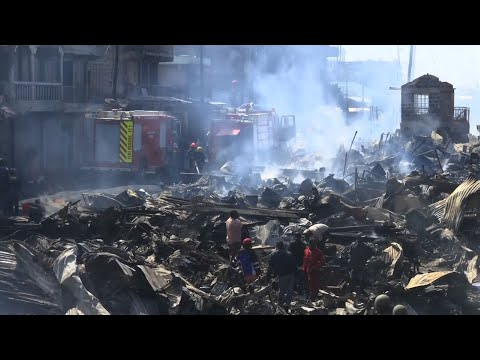 Raw: Dozens Dead or Hurt in Naibori Market Fire