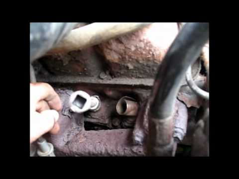 1994 Dodge Ram. how do you get spark plugs out?