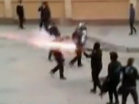 Raw: Egypt Soccer Fans, Security Forces Clash