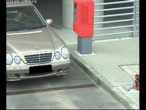woman trying to drive out of the parking..