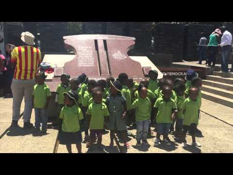 South African school children singing and dancing