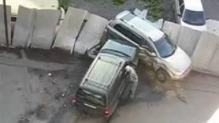 චපල සැමියාට දඬුවම ලෙස රථය කුඩු කරණ යකඩ බිරිඳක්   Angry wife crashes husband's SUV into their jeep