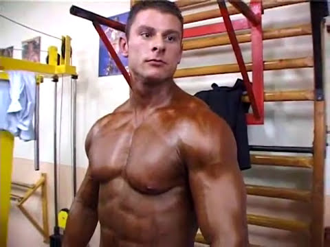 bodybuilders getting oiled up.flv