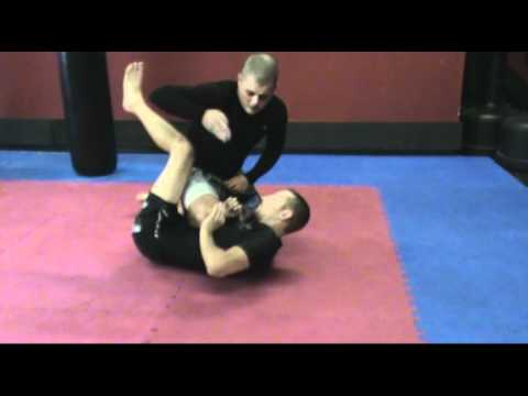 X-Guard Sweep to Farside Armbar Image 1