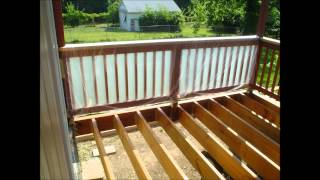 Applying Cabot Australian Oil (Natural) to the deck joists and beams