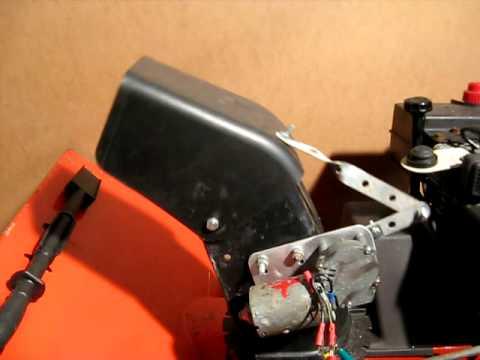 Electric snowblower chute deflector