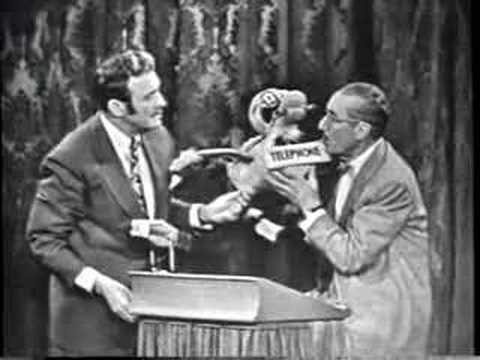 "On his TV show, Jack Benny plays a contestant on Groucho's ""You Bet Your Life"" Program. That's Irene Tedrow in between the two masters. This is just a treasure I have to share."