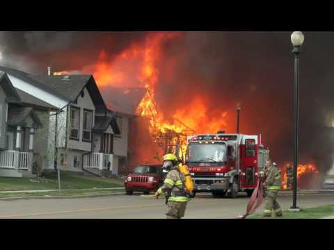 Photos By Jeff Stokoe Red Deer Advocate staff � Four homes were destroyed in a devastating fire in a Sylvan Lake neighborhood late Tuesday afternoon. The ambient heat enough to peel...