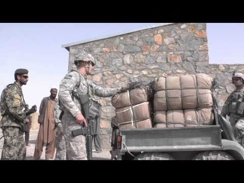 Soldiers Help Afghan Villagers After Flood Damage