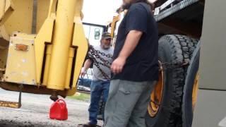 Pulling tire off of 110 ton crane