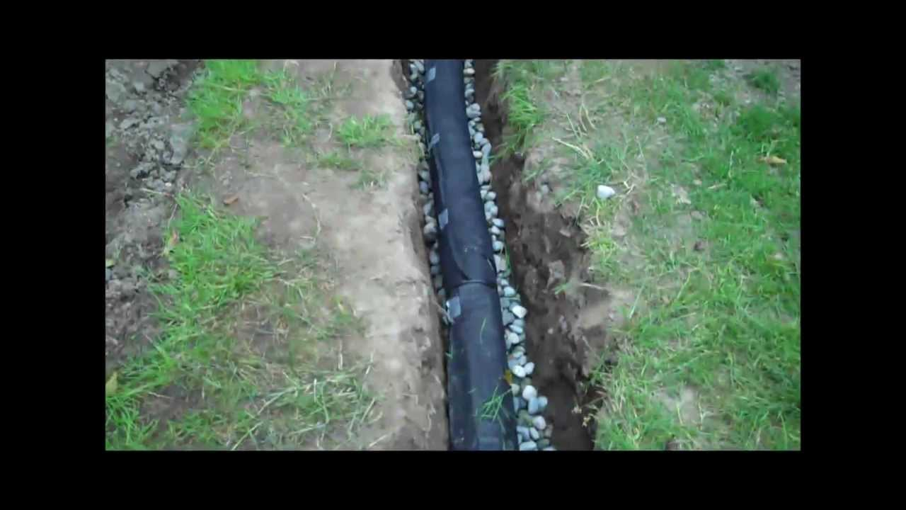 How to install a drainage pipe youtube for Installing drainage pipe in yard