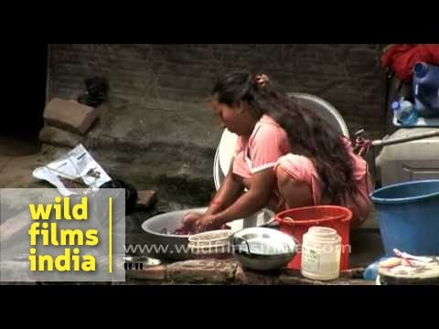 Woman washing clothes in Kathmandu