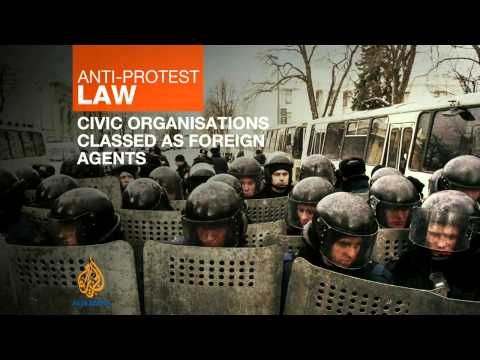 Ukraine's leader approves anti-protest laws