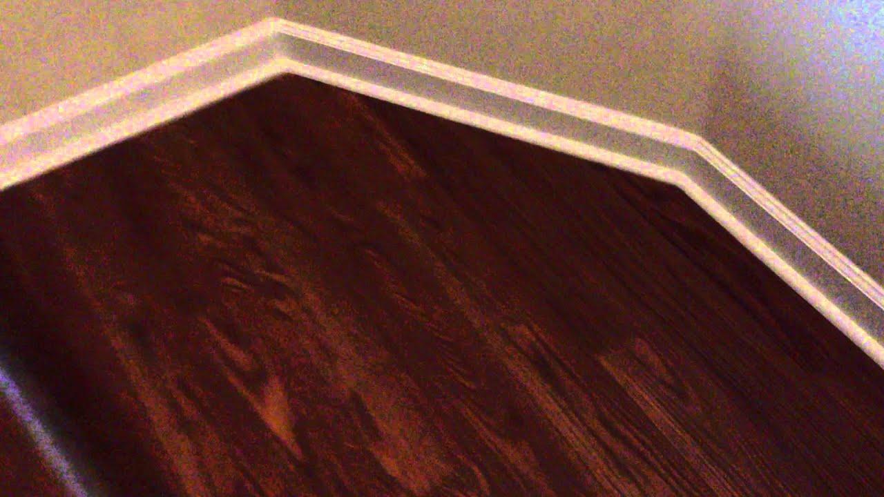 Laminate flooring with white quarter round youtube for Hardwood floors quarter round