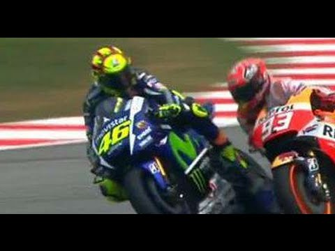 MotoGP 2015  Sepang Malaysia Incident Rossi Kick Marquez get physical slowmotion sports news
