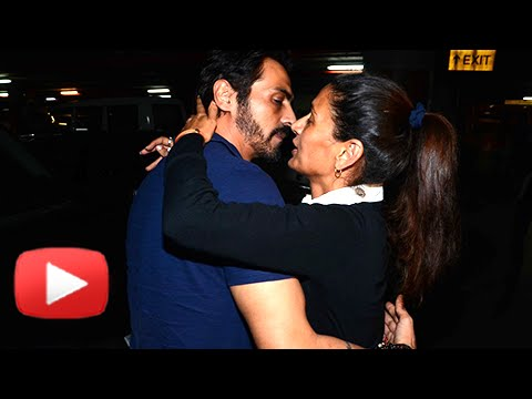 Arjun Rampal's Romantic Kiss To Wife Mehr At Airport