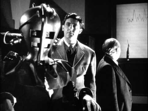 Karloff is obsessed with the idea of communicating with his late wife, so he rigs up corpses in robot suits connected electrically to a live medium (Revere). When the experiment kills Revere,...