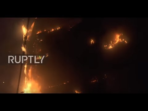 UK: A child 'went to the window and jumped' – eyewitnesses outside burning Grenfell tower
