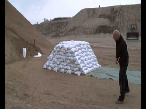 Sandbags - Building a barrier of sandbags for flood protection